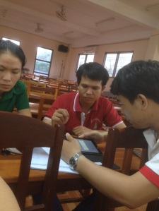 Enumerator under training in using tablet